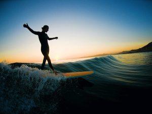 woman-longboarding-sunset-600